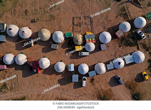 Aerial view of a yurt camping site on the banks of the saltwater lake Issyk-Kul in Kyrgyzstan