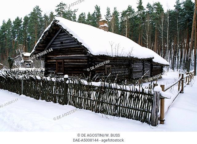 Wooden rural building under the snow, Open-air ethnographic museum, Riga, Latvia