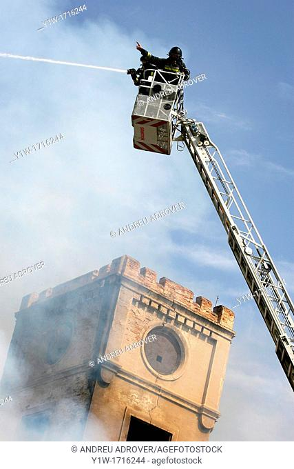 Firemen extinguishing fire at Can Ricart, Barcelona, Spain