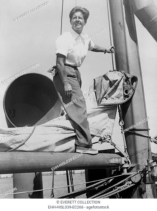 Joe Carstairs on the rigging of her yacht Sonia 2 in 1944. Marion Barbara 'Joe' Carstairs was openly lesbian, wore men's clothes, tattooed her arms