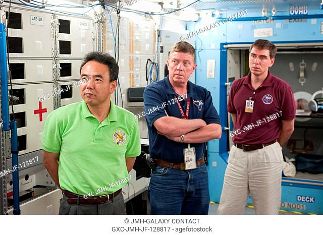 NASA astronaut Mike Fossum (center), Expedition 28 flight engineer and Expedition 29 commander; along with Japan Aerospace Exploration Agency (JAXA) astronaut...