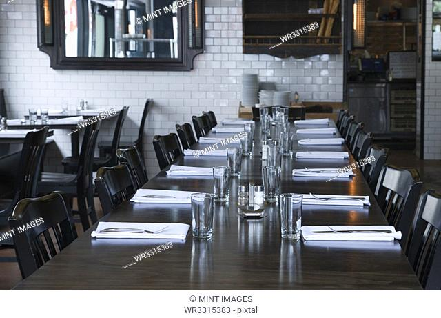 Place settings at table in empty restaurant
