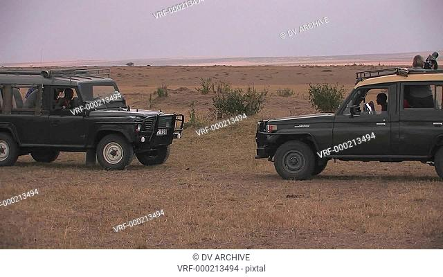 Two off road vehicles in a savanna