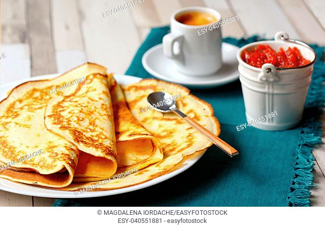 Pancakes with jam and Espresso on the wooden table