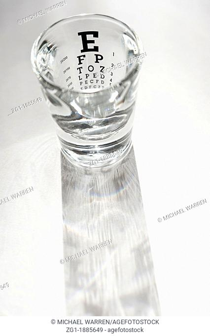 Spirits Shot Glass with an eye test chart printed on it