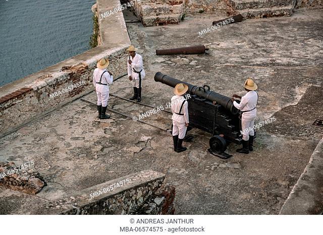 The fortress of Santiago de Cuba, soldiers preparing the cannon shot every evening at sundown, Castillo San Pedro de la Roca, Cuba