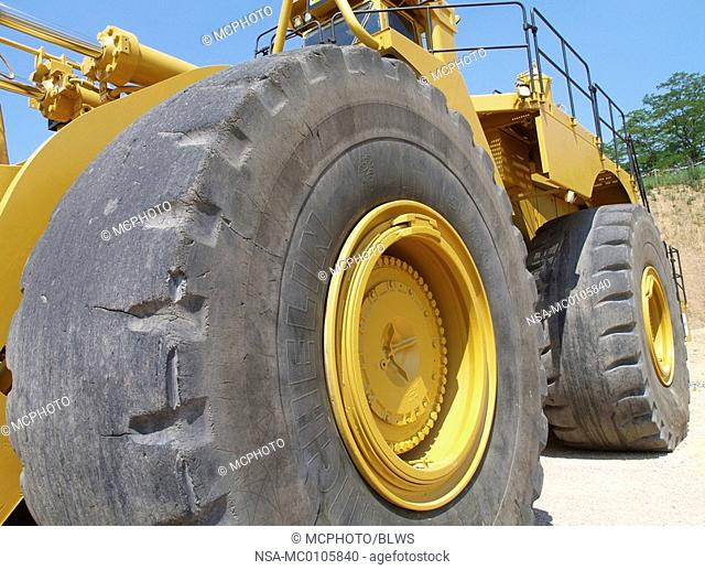 big wheels of an excavator for surface mining