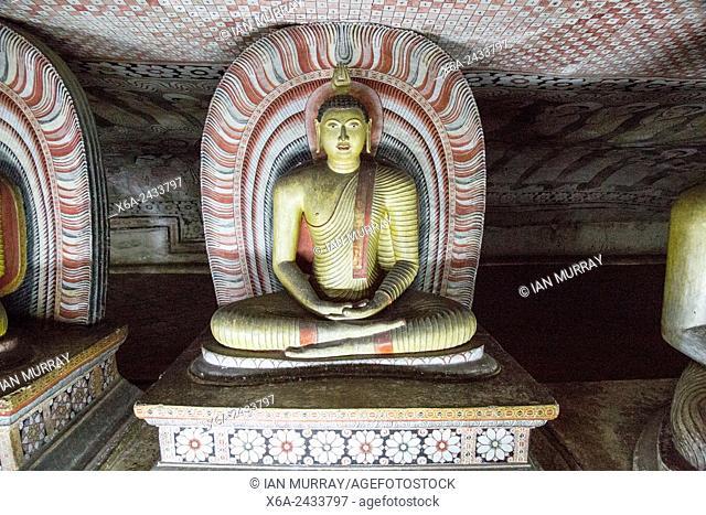 Buddha statue figure inside Dambulla cave Buddhist temple complex, Sri Lanka, Asia