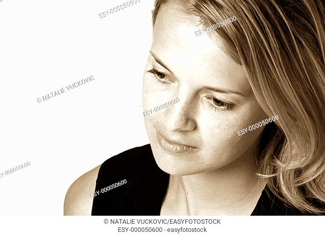 Blond woman looking down at angle