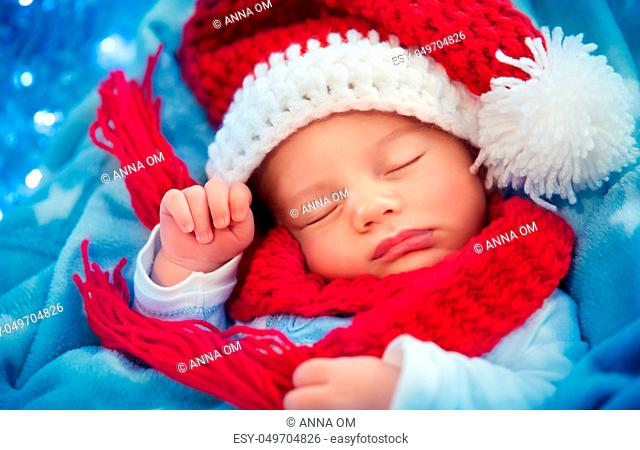 216955c6a Cute baby on blue knitted blanket Stock Photos and Images | age ...