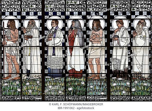 Statues of holy men, Art Nouveau stained glass window by Kolo Moser, Kirche Am Steinhof church, by Otto Wagner, Baumgartner Hoehe heights, Vienna, Austria