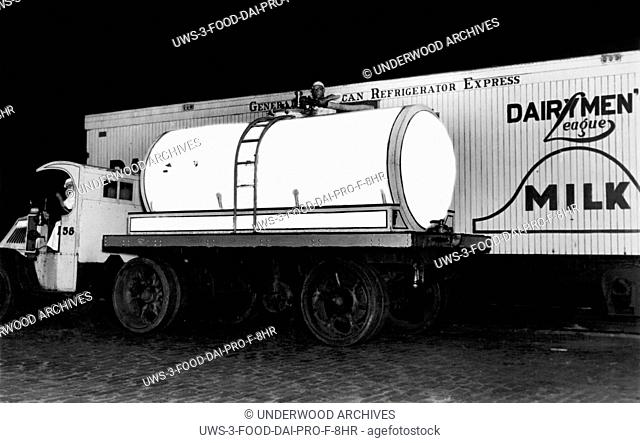 New York, New York: c. 1928 A new Borden's MIlk truck shows the latest in milk transport. Both the truck and the train are equipped with seamless glass...