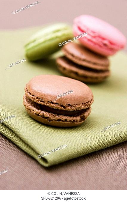 Coloured macarons on a tablecloth