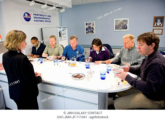 STS-133 crew members participate in a food tasting session in the Habitability and Environmental Factors Office at NASA's Johnson Space Center