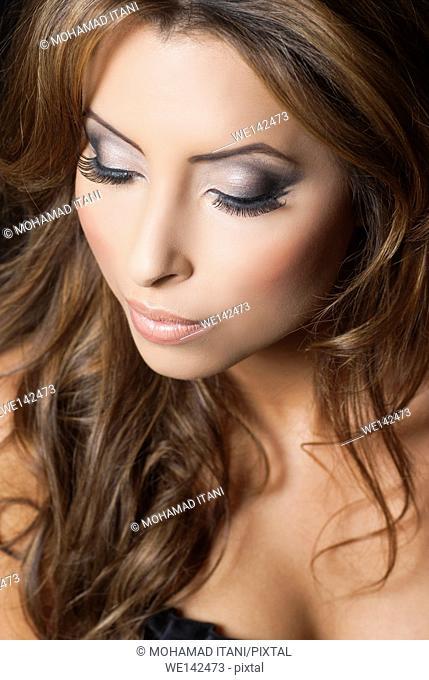 Beautiful young woman wearing make up