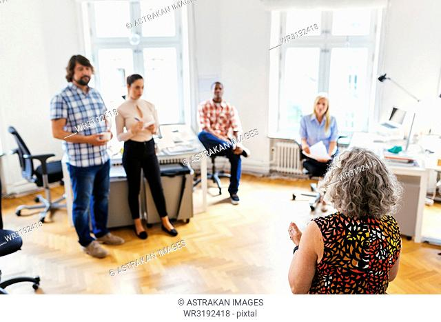 Coworkers during business meeting in office
