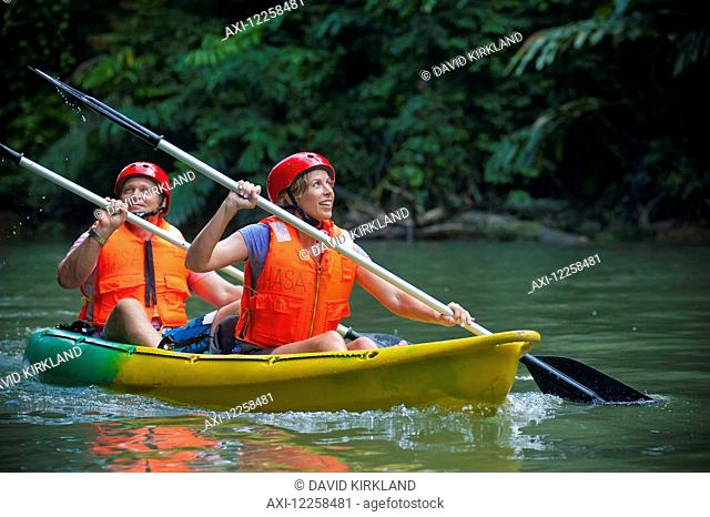 Tourists paddling in a canoe in Ulu Temburong National Park; Brunei