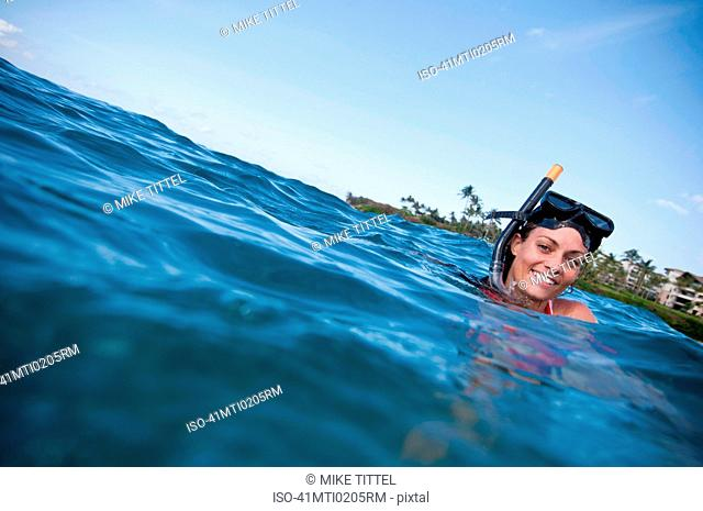 Woman snorkeling in tropical ocean