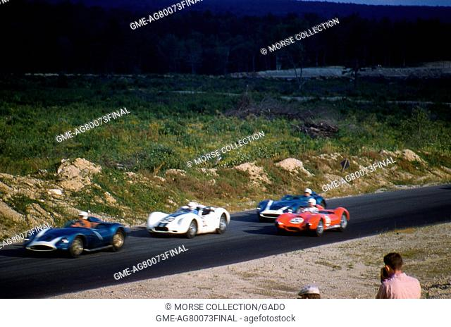 Action view of sports cars driving at speed during the SCCA National Races in Montgomery, New York, August 17, 1958. At left edge is Chuck Daigh driving the RAI...
