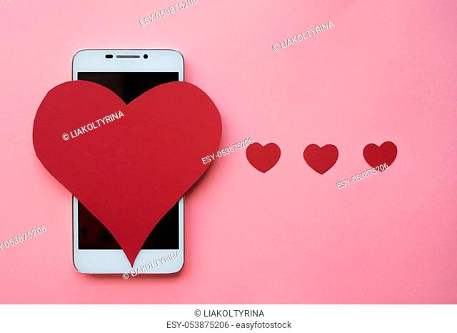 Many hearts and smartphone. The concept to like in social networks or Dating app