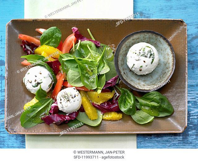 Wild garlic & cream cheese balls with orange & lamb's lettuce salad