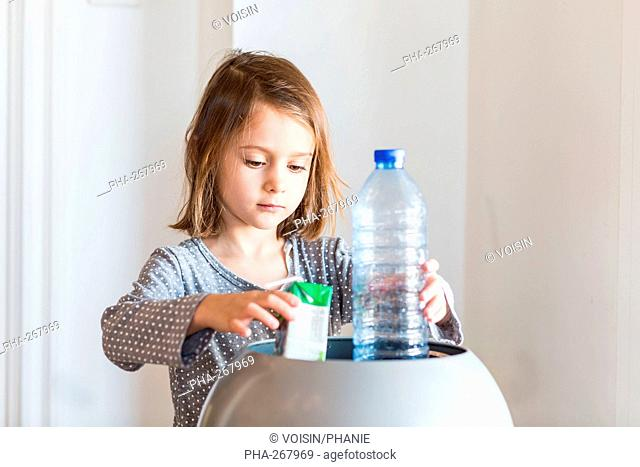 Girl sorting recycled wastes