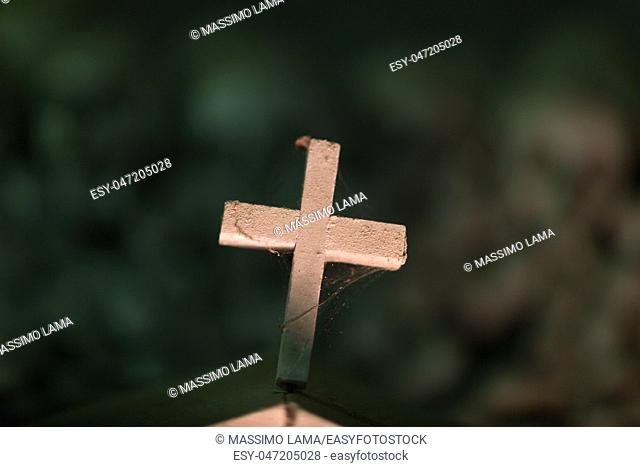 cross and bonesa in ancient ossuary as backround , Naples