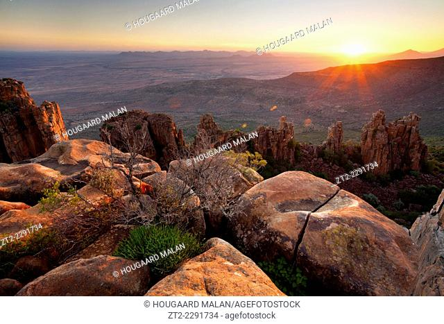 Landscape photo of a sunset over a mountainous Karoo landscape. Valley of Desolation, Graaff-Reinet, Eastern Cape, South Africa