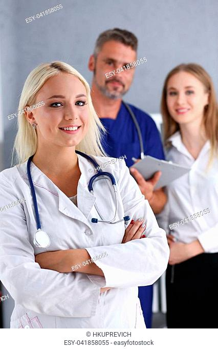 Beautiful smiling female doctor stand in office portrait. Physical and patient disease prevention exam er ward round 911 prescribe remedy healthy lifestyle...