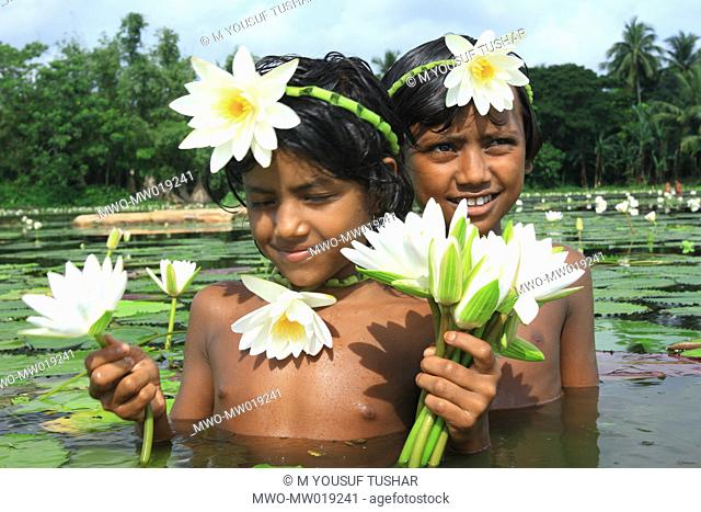 Children wearing ornaments made of water lily, the national flower of Bangladesh Jessore, Bangladesh September 16, 2007