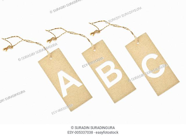 Brown paper tag with letter A B C cut