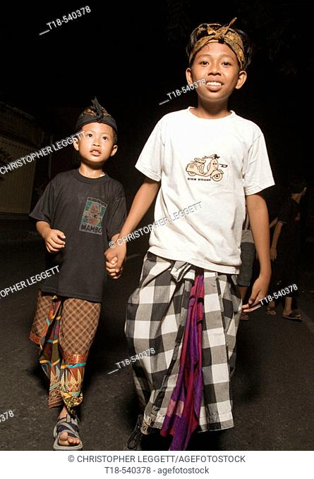 two balinese boys in traditional clothing