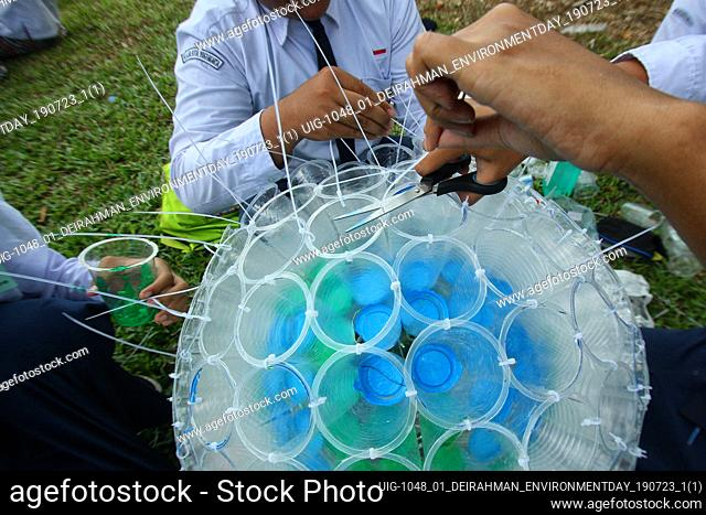 A number of students seen are making lanterns originating from plastic waste in Yogyakarta Indonesia, Monday, July 22, 2019