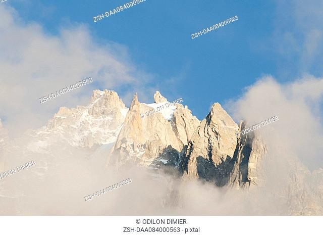 Mountain peaks surrounded by clouds