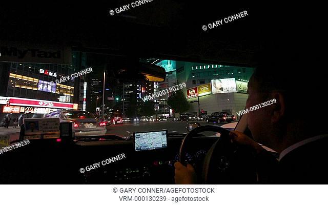 Taxi drive through Shinjuku in Tokyo, Japan