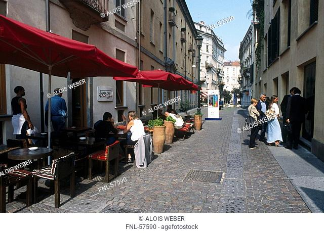 People at sidewalk cafe, Turin, Piedmont, Italy