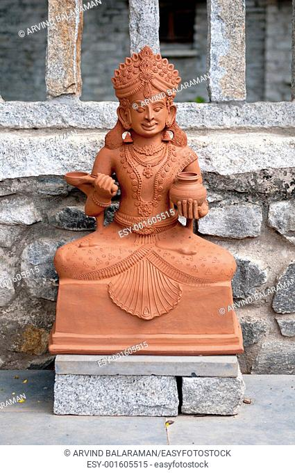 A traditional Indian goddess made of clay at display