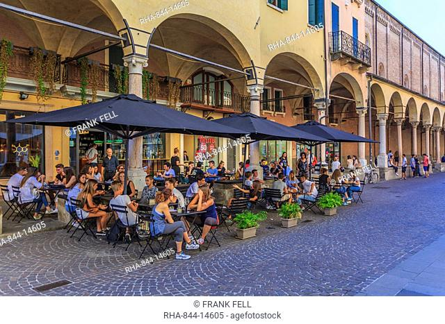 View of pastel coloured architecture, pedestrians and cafe on cobbled street of Via Roma, Padua, Veneto, Italy, Europe