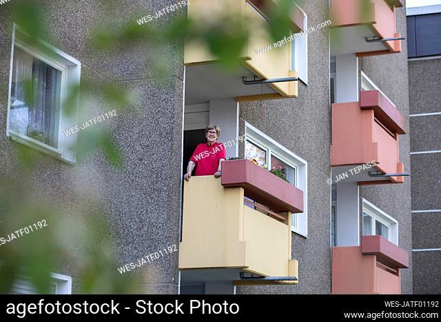 Senior woman on balcony, retirement home