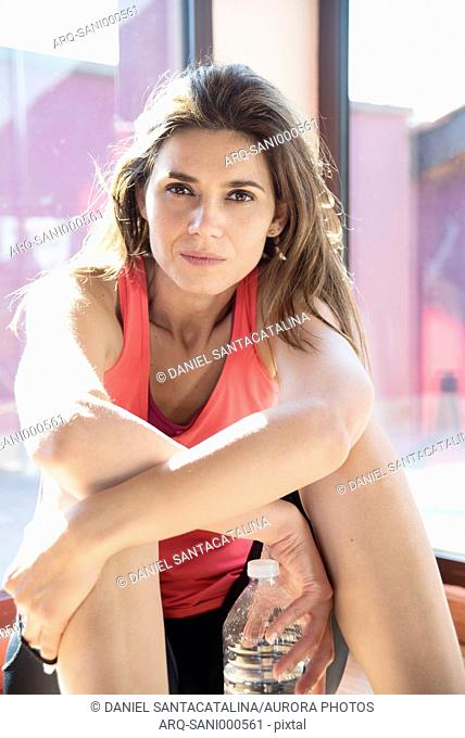 Portrait of smiling sportswoman before workout looking at camera, Gurb, Barcelona, Catalonia, Spain
