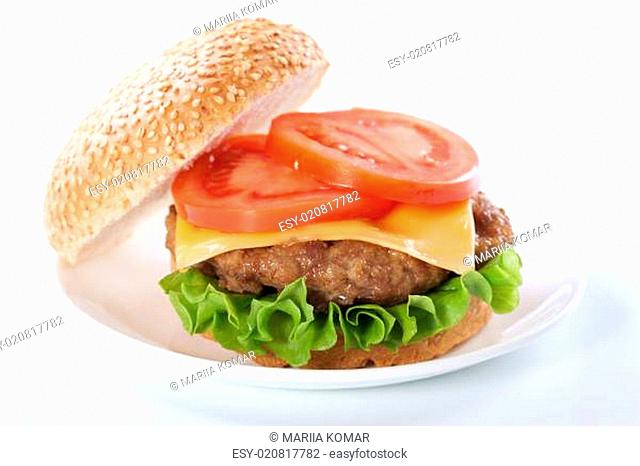 Cheeseburger with tomatoes and lettuce