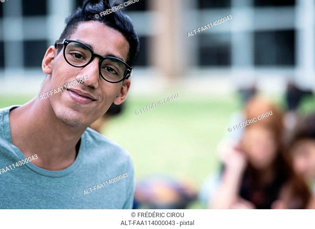 Male college student outdoors, portrait