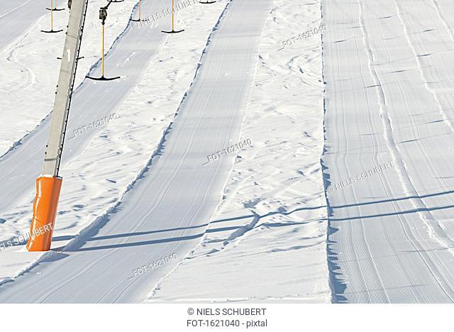 Full frame shot of freshly groomed corduroy covers ski trail