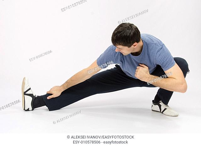 thirty young athletic man does physical exercises