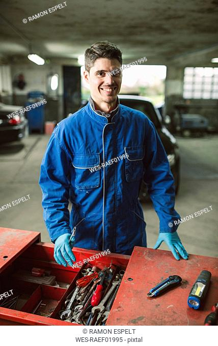 Portrait of smiling mechanic in his workshop