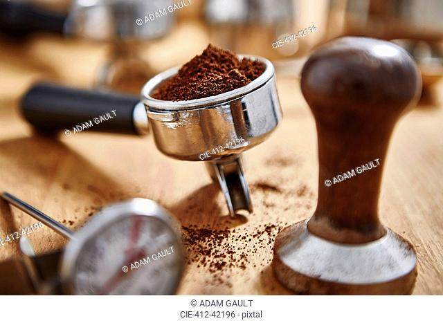 Espresso grounds and coffee tamper