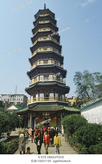 Octagonal Flower Pagoda within the compound of the Temple of the Six Banyan Trees. Exterior view with people on the pathway outside