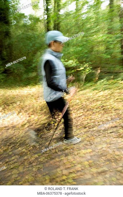 Woman while Nordic Walking