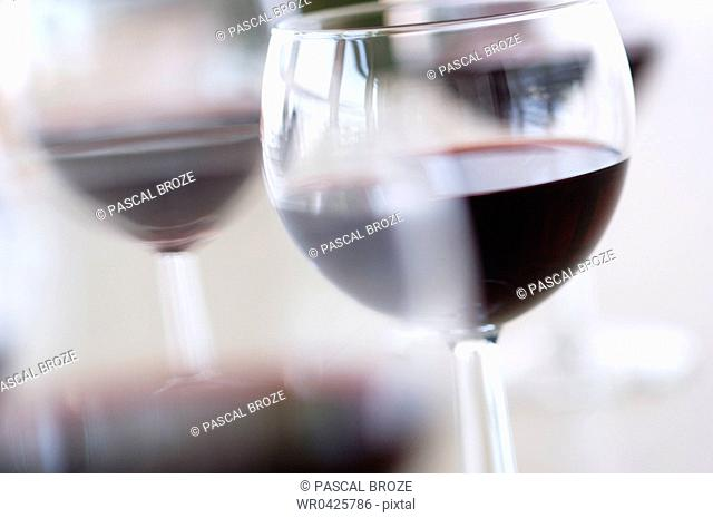 Close-up of glasses of red wine