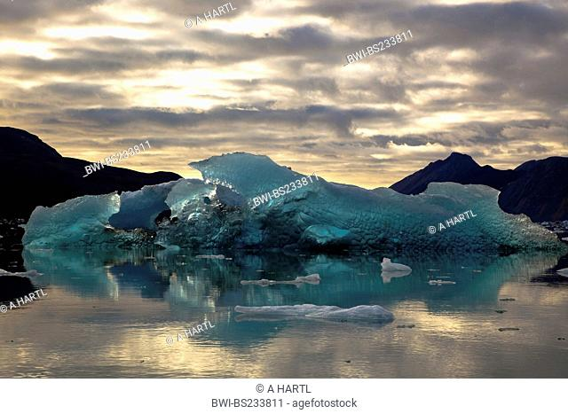 weirdly shaped iceberg in the light of midnight sun, Norway, Svalbard, Kongsfjord, Ny Alesund